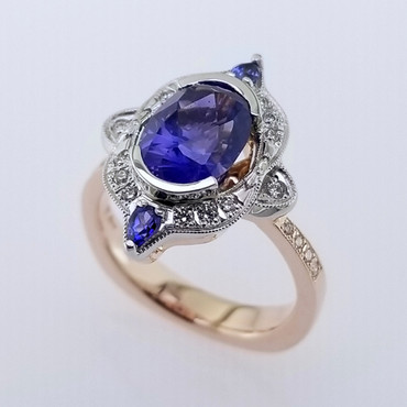 Wed- 400- Custom designed alternative engagement ring using this 2.77 ct. oval no heat sapphire, and mixing white gold, and rose gold. Adding some sparkly diamonds, and 2- pear shaped blue sapphires, makes this ring absolutely perfect! Magnificent!
