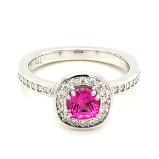 Beautiful, custom made, halo engagement ring in 14 karat white gold, with .25ct. T.W. of ideal cut diamonds, and a .68ct. cushion cut Chatham(r) created, rich, deep pink sapphire gemstone. Simply perfect! Custom designed in our studio by the artist, Stuart J.   This elegant ring is available in any karat or color of gold, and in platinum. Call us for more options.