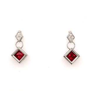 Modern and elegant dangle earrings, created in 14 karat white gold, set with .07ct. T.W. of our super sparkly ideal cut diamonds, and Chatham(r) created square cut rich, ruby gemstones. So special! Measures 1 inch long. Designed and created in our studio by the artist Stuart J.