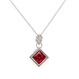 "This captivating dangly pendant will take her breath away! Modern and elegant, handmade in 14 karat white gold, set with .04ct. T.W. of our super sparkly ideal cut diamonds, and a spectacular 1.45ct. rich red Chatham(r) created square ruby gemstone. Hangs on a 14 karat white gold, 1mm adjustable round cable chain, 16-18"" long. Designed and created in our studio by the artist, Stuart J."