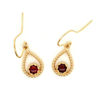 You will be captivated by this mix of modern and vintage in these sweet and sassy dangle earrings. Handmade in 14 karat yellow gold, with rich, buff top garnet gemstones. You will have so much fun wearing them day or night.  Measures 1 inch long and hangs on 14 karat yellow gold wires.  Designed and created in our studio by the artist, Stuart J. We can make these with your favorite gemstones