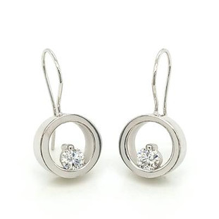 """These earrings are truly timeless. Beautiful circles with floating Diamonds at the bottom. 14 karat White Gold, with .50ct T.W. Ideal cut  Diamonds hanging on wires. Measure 1"""" long.  Designed and handmade by the artist Stuart J."""