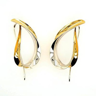 Jewelry to soothe and flow, our Chi earrings are the perfect drop earring with a twist. Hand-forged silver and 18 karat yellow gold. Elegant, casual, and comfortable with a modern flare. These amazing hoop earrings stand 1 1/2 inches tall.
