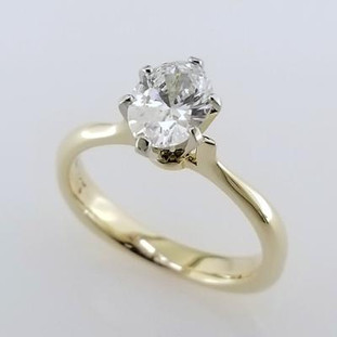 Simplicity at its best, this timeless, but modern 14 karat yellow gold solitare engagement ring is the perfect ring to set off any diamond. We set an 8x6 Oval diamond (sold separately), but we can set any shape, or size you desire. We will even set your diamond. Available in any color gold, or platinum. Designed and created in our studio by the artist, Stuart J.