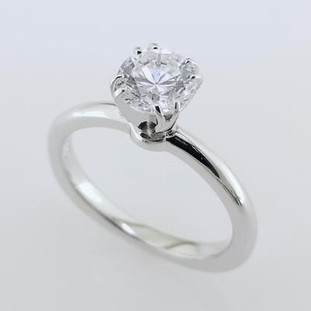 This elegant, and timeless solitare has a modern flare. Shown here in 14 karat white gold, with a 1ct round diamond (sold separately), showcasing the diamond beautifully. Available in any color gold, or platinum, and with any size diamond. We will also set your diamond. Designed, and created in our studio by the artist, Stuart J.