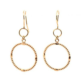 "Circles never go out of style, and these dangle circle earrings will not disappoint.  14 karat yellow gold with a little vintage, and a little modern all at the same time. These earrings are the perfect gift, or self purchase. Measure 1"" long, and hangs on yellow gold wires.   Also available in other  metals, but will take 2 weeks for delivery.  Designed, and created in our studio by the artist Stuart J."