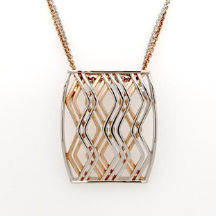 """For the person who likes to be unique, this stylish pendant does not disappoint. Created in silver and rose gold plated, this criss cross pattern delights.  Hangs on a 18"""" double silver and rose gold plated chain to match the pattern of this pendant.  A perfect fit!  This pendant measures 1 3/4 inches long."""