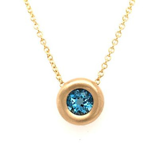 """There is nothing more timeless then our beautiful bezel pendant. Created in 14 karat yellow gold, set with this dreamy 7mm round swiss blue topaz gemstone.  Looks like candy on your neck! Hangs on a 14karat yellow gold 1.1mm wheat chain 16"""". This bezel pendant measures 1/4 inch long.  Other gemstone colors available, so call with options.  Designed and created in our studio by the artist Stuart J."""