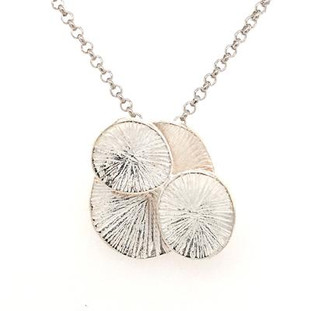 """For that down to earth organic girl, this flower pendant is the perfect fit.  Created in silver, with four oval shapes blending together to feel like a flower. Nature at it's best! Hangs on a 18"""" silver wheat chain. Measures 3/4 inch long."""