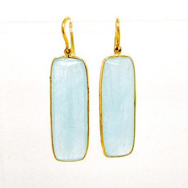 For the girl who loves fun, these earrings are the perfect match! 18 Karat yellow gold, set with these amazing rectangle aquamarine gemstones.  Hangs on wires, and measures 1 1/2 inches long.