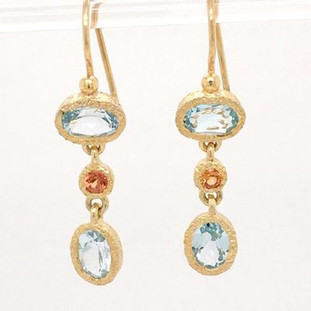 These sweet earrings sing! Created in silver and gold plated, bezel set with light blue topaz, and orange sapphire gemstones! The perfect everyday dangle earring. Hangs on wires and measures 1 inch long.