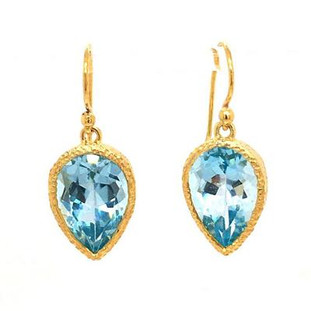 Super pretty, vermeil (gold plate on sterling silver) drop dangle earrings, with light blue pear shaped blue topaz gemstones. Measuring 3/4 inch long, hanging on wires.