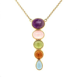 "For the girl who loves adventure and fun, this multi color gemstone pendant is the perfect fit! 18 karat yellow gold, with multi color cabachon gemstones consisting of amethyst, rose quartz, peridot, citirine, and blue topaz! An 18 karat yellow gold oval link chain, 18 "" long, is included."