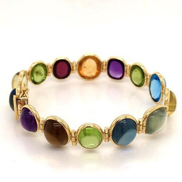 This magnificent hand made gemstone bracelet will make you sing! Dreamy 18 karat yellow gold, with bold and colorful cabachon gemstones from Brazil, a veritable rainbow! The genuine gemstones include Amethyst, Citrine, Peridot, Blue Topaz, and Garnet. This bracelet measures 7 inches long.