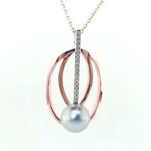 This stunning, modern pendant will take your breath away! Created in recycled 14 karat rose and white gold, with 0.11 carat of our super sparkly ideal cut diamonds, and featuring an amazing 9.9mm silver Tahitian pearl. Exotic is this pendant's middle name!  Includes a 1mm 14 karat rose gold cable chain, 18 inches long. Measures 1 1/2 inches long.  Designed and created in our studio by the artist, Stuart J.