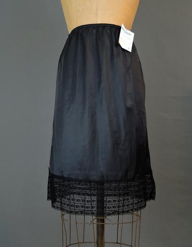 1970s Black Nylon Snip-A-Row Half Slip, 24 to 28 waist