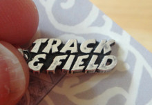 says Track and Field Word Sterling Silver Charm only