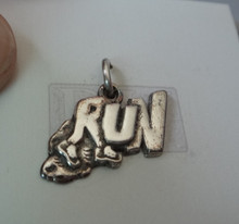 17x15mm Says Run with Shoes on ends of R Sterling Silver Charm