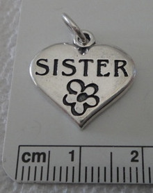 says Sister with flower on Heart Sterling Silver Charm!
