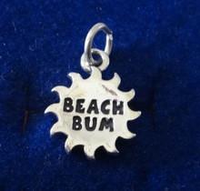 says Beach Bum on a Sun Sterling Silver Charm