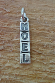 5x23mm says NOEL Sterling Silver Charm