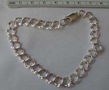 """7"""" Sterling Silver 7 mm Diamond Cut Double Charm Bracelet"""