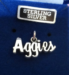 9x19mm Texas A&M University Aggie ATM says Aggies in cursive Sterling Silver Charm