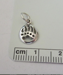 TINY 11x8mm Sterling silver Cut Out Bear Claw Paw Mascot Charm