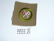 Signaling with reversed flags- Type A - Square Tan Merit Badge (1911-1933)