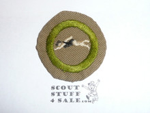 Swimming - Type B - Wide Crimped Bdr Tan Merit Badge (1934-1935), was sewn but in very good condition