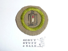 Metalwork - Type B - Wide Crimped Bdr Tan Merit Badge (1934-1935), was sewn but in very good condition