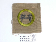 Wood Turning - Type A - Square Tan Merit Badge (1911-1933), lt use