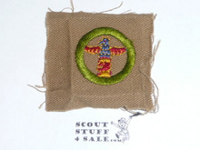 Wood Carving - Type A - Square Tan Merit Badge (1911-1933), lt use