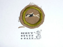 Swimming - Type A - Square Tan Merit Badge (1911-1933), Material folded under with some trimming