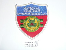 Schiff Scout Reservation, National Junior Leader Instructor Training Camp Shield Patch, Three Lines of Text, 10 stiches of thread hole it to leather backing