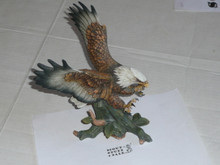porcelin eagle statue, 6.5 wide by 9.5 tall