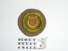 Music - Type B - Wide Crimped Bdr Tan Merit Badge (1934-1935)