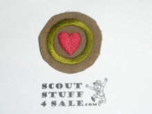 Personal Health - Type B - Wide Crimped Bdr Tan Merit Badge (1934-1935)