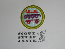 Skating (bright colors)- Type J - Fully Embroidered Merit Badge with Scout Stuff backing (2002-current)