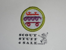 Skating (bright colors)- Type K - Fully Embroidered Merit Badge with 100th Anniv backing (2010)