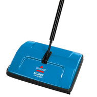 The BISSELL Sturdy Sweep™ has 4 small brushes placed on the corners of its foot, in addition to its main floor brush. These small brushes help to capture the dirt and debris along baseboards and in corners that the main floor brush (located in the center of the foot), can't get to. These are also helpful when maneuvering around furniture, as the corner brushes will catch the dirt right up against furniture legs. And since BISSELL sweepers have handles that lie flat, you can clean underneath furniture without moving it around.