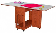 Sunset Maple Cutting Table: order number 2111.91 Features: Melamine (smooth) mar-resistant surface Rounded corners for safety Large work surface Sturdy construction with steel connectors Easy roll lockable casters