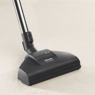 The Miele turbobrush contains a rotating roller brush (activated by the air drawn through the head) that works to loosen the dirt in the floor while collecting lint and thread. This tool works best on cut pile. For use with S2000-8000 series canister vacuums.