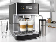 "Miele CM6310 - Black: For more enjoyment together:  All bean-to-cup coffee machines are equipped with the new OneTouch for Two function as well as with the already familiar OneTouch feature. This function allows you to make two delicious coffee specialities at the same time by simply touching a button. The program starts automatically. ""Because preparation takes less time, you have more time together."""