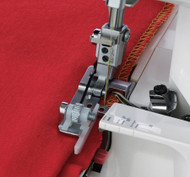 Blind hemming is never an easy technique and demands practice and patience. It is possible to sue your overlocker to blind hem and the blind stitch foot is equipped with a guide to help keep your stitching straight.