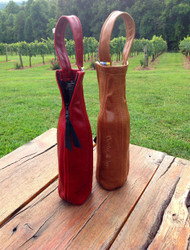 Leather bottle reliquary with free name/logo embroidered   • Made in North Carolina, by Americans • 100% Top grain leather • Customized & Special order capability • Ideal corporate gifts that last forever • Personalized treat for a special friend  • Ideal for wine lovers