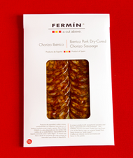 Iberico chorizo sliced 2 oz (56 g) by Fermin   •100% Iberico •Traditional pimento seasoned Spanish sausage •Mild, dry cured •By Fermin •La Alberca, Salamanca Spain •Sliced hand trimmed •Marinated with salt Pimenton and garlic • 2oz (56 g)
