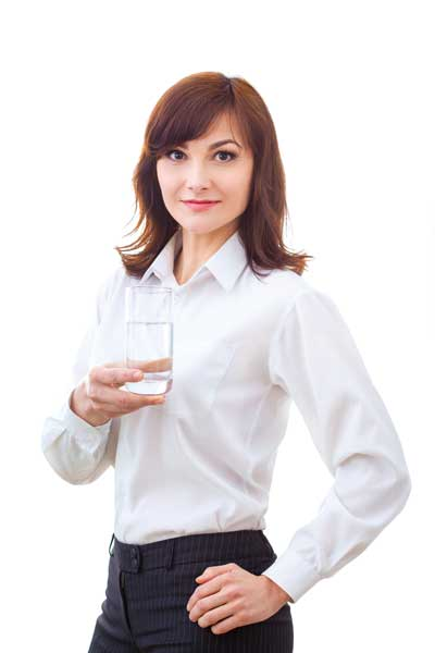 A business woman holding a glass of water