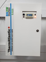 """The latest residential wall mount model is only 16"""" wide x 24"""" tall x 12"""" deep and uses externally mounted circulator and 3 way mixing valve which are included.  Here is the front view.  It comes in two sizes:  3-4 Ton and 4-5 Ton which use different capacity heat exchangers and matched TXVs."""