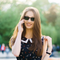 Beautiful woman wearing Sunglasses XL Tortoise, Green Lenses by the side. Polarized sunglasses Blueberry